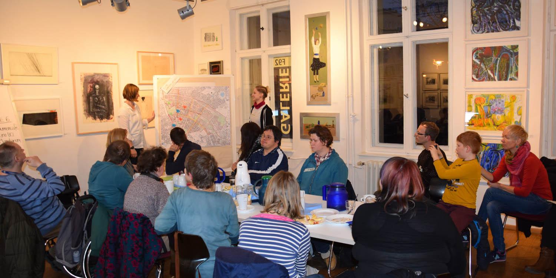 Vortrag mit einem Stadtplan als Plakat