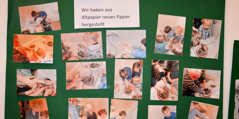 Ein Plakat mit Fotos, auf dem die Kinder aus Altpapier neues Papier gemacht haben.